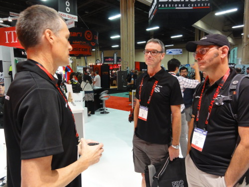 Jerry Gerlich discusses new products with Mark Dwyre and Scherrit Knoesen while at Interbike.
