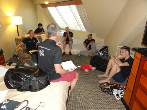 Members of the Steve Hogg Bike Fitting Team meet to discuss bike fitting techniques.